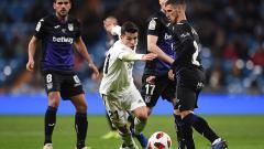 Indosport - Brahim Diaz (Real Madrid) berhasil melewati pemain Leganes pada laga 16 besar Copa del Rey Real Madrid melawan Leganes di Santiago Bernabeu 09/01/19.