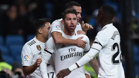 Sergio Ramos melakukan selebrasi bersama rekan satu timnya pada laga 16 besar Copa del Rey Real Madrid melawan Leganes di Santiago Bernabeu 09/01/19. - INDOSPORT