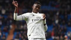 Indosport - Vinicius Junior melakukan selebrasi usai cetak gol pada laga 16 besar Copa del Rey Real Madrid melawan Leganes di Santiago Bernabeu 09/01/19.