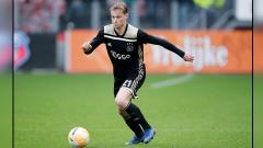 Indosport - Frenkie De Jong, gelandang serang muda milik Ajax Amsterdam.