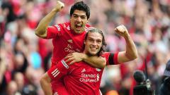 Indosport - Eks penyerang Liverpool, Andy Carroll (bawah), dikabarkan bakal segera kembali ke klub lamanya, Newcastle United.