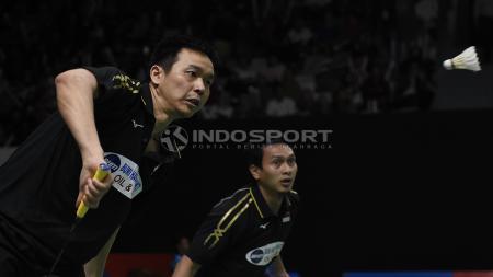 Mohammad Ahsan/Hendra Setiawan, pasangan ganda putra Indonesia ini gagal meraih gelar juara Singapura Open 2019, setelah kalah dari pasangan Jepang di laga final. - INDOSPORT