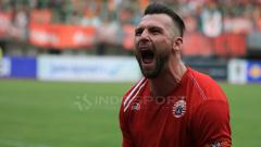 Indosport - Selebrasi Simic setelah mencetak gol untuk Persija Jakarta.