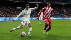 Indosport - Penyerang sayap Real Madrid, Lucas Vazquez mencoba mengirimkan umpan silang saat menghadapi Girona, Jumat (25/01/19)