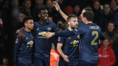 Indosport - Para pemain Manchester United merayakan gol ke gawang Arsenal di Piala FA, Sabtu (26/01/19).
