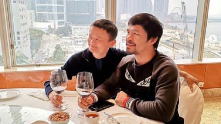 Manny Pacquiao saat bertemu Jack Ma di Hong Kong. - INDOSPORT