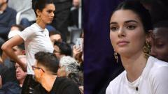 Indosport - Kendall Jenner saat menonton Los Angeles Lakers vs Philadelphia 76ers.