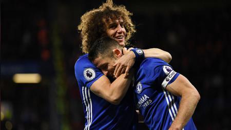 David Luiz (kiri) mengatakan kalau Chelsea masih tim langganan juara meski sering ganti pelatih, termasuk kini Frank Lampard. - INDOSPORT