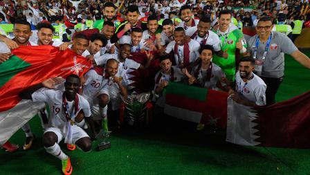 Para pemain Timnas Qatar merayakan kemenangan sebagai juara Piala Asia melawan Jepang di Stadion Zayed Sports City pada (01/02/19) di Abu Dhabi, Uni Emirat Arab.