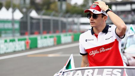 Bos Ferrari, Mattia Binotto cukup puas dengan performa pembalap mudanya, Charles Leclerc. - INDOSPORT