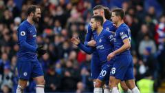 Indosport - Selebrasi Pemain Chelsea Usai Kalahkan Huddersfield.