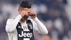 Indosport - Cristiano Ronaldo, pemain megabintang Juventus sedih.