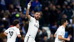 Indosport - Karim Benzema merayakan golnya yang dicetak ke gawang Alaves.