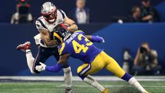 Indosport - Situasi Julian Edelman (New England Patriots)  dihalau John Johnson