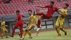 Indosport - Bhayangkara FC vs Timnas Indonesia U-22.