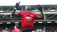 Indosport - Selebrasi Paul Pogba (Manchester United) usai mencetak gol pertama ke gawang Fulham.