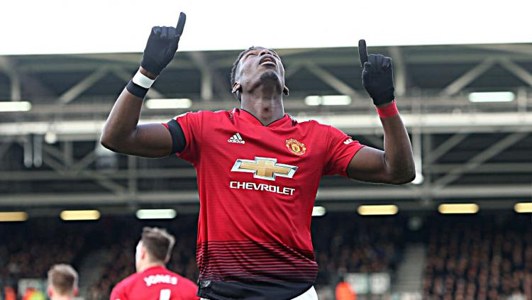 Selebrasi Paul Pogba (Manchester United) usai mencetak gol pertama ke gawang Fulham. Copyright: GettyImages