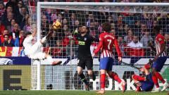 Indosport - Gol salto Casemiro ke gawang Atletico Madrid
