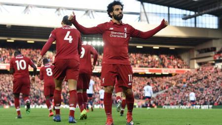 Mohamed Salah menjadi korban tindakan berbau rasisme di sepak bola Inggris. - INDOSPORT