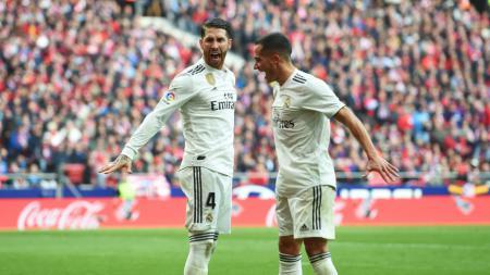 Selebrasi Sergio Ramos usai cetak gol ke gawang Atletico Madrid - INDOSPORT