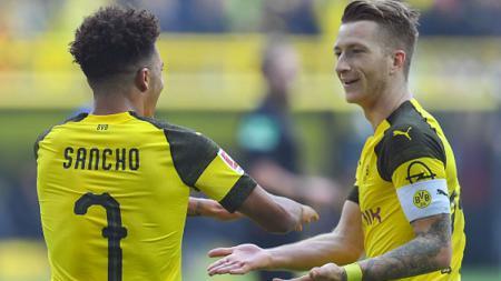 Kapten Borussia Dortmund, Marco Reus, mencoba menghalang-halangi kepindahan Jadon Sancho ke Manchester United pada bursa musim panas nanti. - INDOSPORT