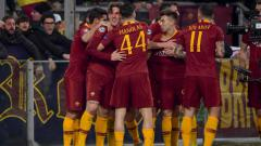 Indosport - Selebrasi para pemain AS Roma saat Nicolo Zaniolo mencetak golnya ke gawang Porto di Liga Champions, Rabu (13/02/19).