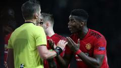 Indosport - Paul Pogba diusir keluar saat laga Manchester United vs Paris Saint-Germain.