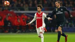 Indosport - Ajax vs Real Madrid di leg pertama babak 16 besar Liga Champions 2018/19.