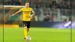 Indosport - Marco Reus, playmaker Borussia Dortmund tetap merasa yakin jika timnya mampu meraih gelar juara Bundesliga 2018/19.