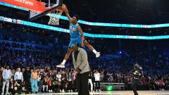 Indosport - Halidou Diallo, shooting guard milik Oklahoma City Thunder, pemenang slam dunk contest 2019.