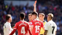 Indosport - Sergio Ramos saat diberikan kartu merah oleh wasit
