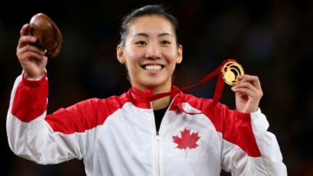 Michelle Li, pebulu tangkis naturalisasi Kanada bisa menjadi penghalang utama Indonesia untuk memutus puasa gelar sektor tunggal putri di Macau Open 2019. - INDOSPORT