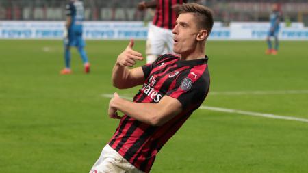 Striker AC Milan, Krzysztof Piatek, saat merayakan gol kontra Empoli. - INDOSPORT