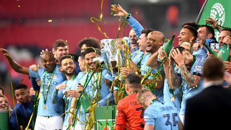 Pemain Manchester City merayakan kemenangan sebagai juara Piala Liga Inggris - INDOSPORT