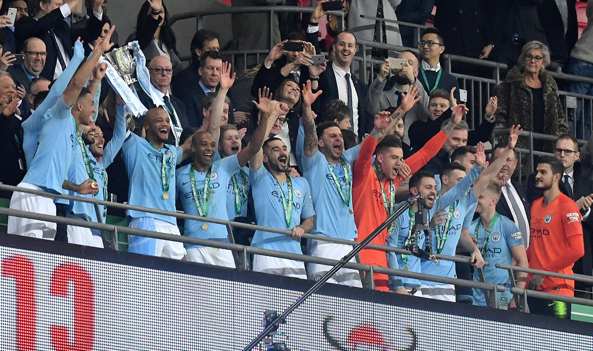 Pemain Manchester City merayakan kemenangan sebagai juara Piala Liga Inggris Copyright: INDOSPORT