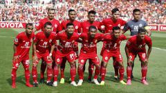 Indosport - Skuat utama Persija Jakarta saat melawan Becamex Binh Duong pada laga perdana Piala AFC 2019 grup G di stadion GBK, Selasa (26/02/18).