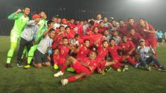 Indosport - Tim Timnas Indonesia U-22 merayakan kemenangan sebagai juara Piala AFF U-22