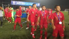 Indosport - Penggawa Timnas Indonesia melakukan selebrasi usai menerima medali