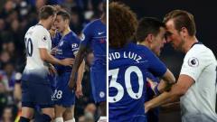 Indosport - Harry Kane menanduk Cesar Azpilicueta di laga Chelsea vs Tottenham Hotspur.