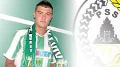 Indosport - Yevhen Bokhashvili dan logo PSS Sleman.