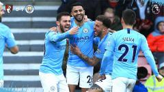 Indosport - Skuat Man City merayakan gol Mahrez ke gawang Bournemouth.