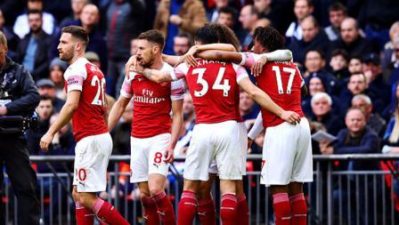 Selebrasi para pemain Arsenal merayakan gol dari Aaron Ramsey ke gawang Tottenham Hotspur.