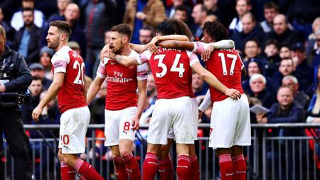 Selebrasi para pemain Arsenal merayakan gol dari Aaron Ramsey ke gawang Tottenham Hotspur. - INDOSPORT