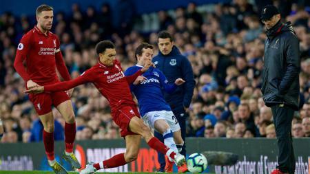 Liverpool siap tempur menghadapi derby Merseyside melawan Everton yang akan menjadi laga pertama mereka setelah kompetisi terhenti akibat pandemi corona. - INDOSPORT