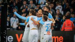 Indosport - Selebrasi gol Mario Balotelli bersama pemain Marseille lainnya, Senin (04/03/19).