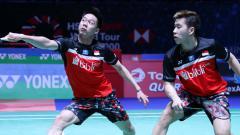 Indosport - Aksi pasangan ganda putra bulutangkis Indonesia, Kevin Sanjaya Sukamuljo/Marcus Fernaldi Gideon.
