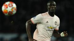 Indosport - Eric Bailly saat pertandingan PSG vs Manchester United di leg kedua babak 16 besar Liga Champions, Kamis (07/03/19).