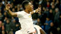 Indosport - Marcus Rashford merayakan golnya ke gawang PSG