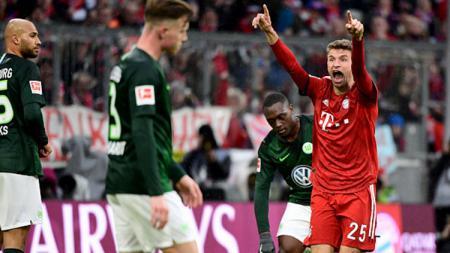Manchester United dikabarkan ingin memboyong dua pemain dari Bundesliga yakni Thomas Muller dan Kai Havertz. - INDOSPORT