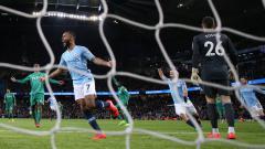 Indosport - Raheem Sterling berselebrasi pasca cetak gol ke gawang Watford
